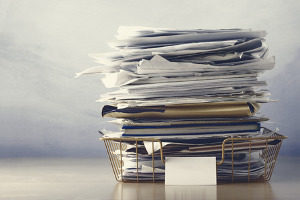 stack of paperwork including employer information