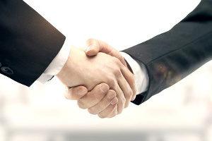 man shaking hands with his Northern VA J1 visa sponsor