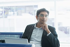 Indian citizen who is waiting for his flight at the airport in order to enter the United States on an EB-5 investor visa