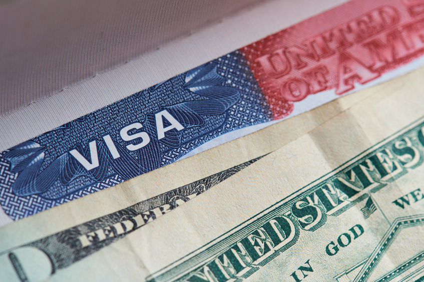 H-B1 Visa with money on top of it.jpg
