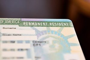 a green card that an EB-5 visa holder is applying for while he is working in the United States