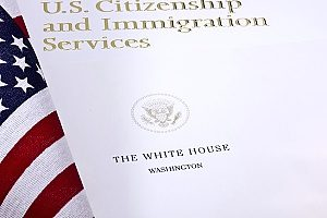 a packet of information about EB-5 visa funding from the USCIS to be followed by a business owner in Fairfax, VA