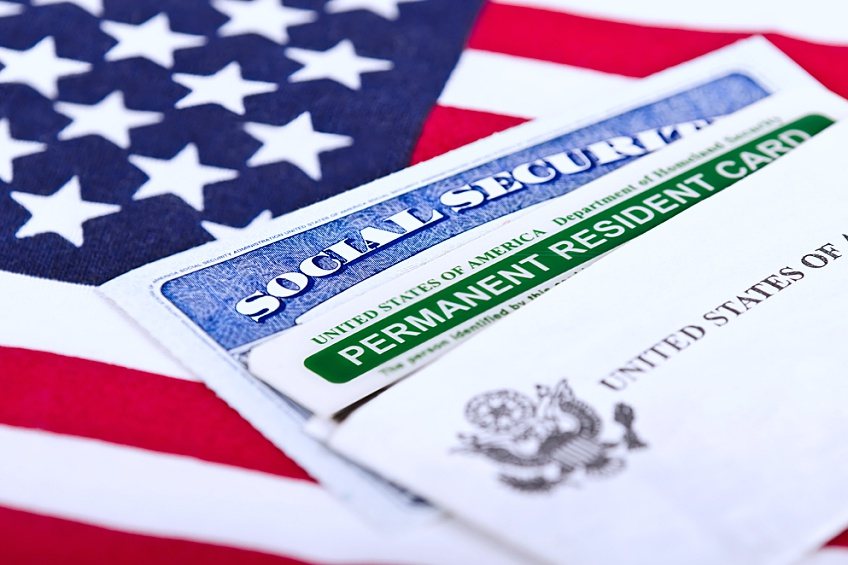 social security and permanent resident cards that an individual was granted after updating their EB-5 visa status so they could become a permanent resident of the United States