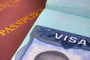an EB-5 visa on top of a passport that is being used by a foreign investor after he cleared up his RFE and was approved