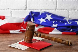 immigration attorney gavel in front of an American flag