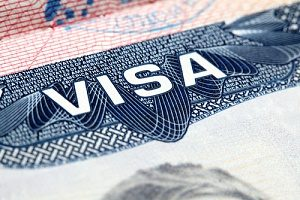 an H1B visa in which the owner initially received H1B visa premium processing from the USCIS