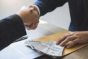 a fraudulent business man accepting bribery for an h1b visa sponsorship