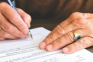 a man signing an H1B RFE petition