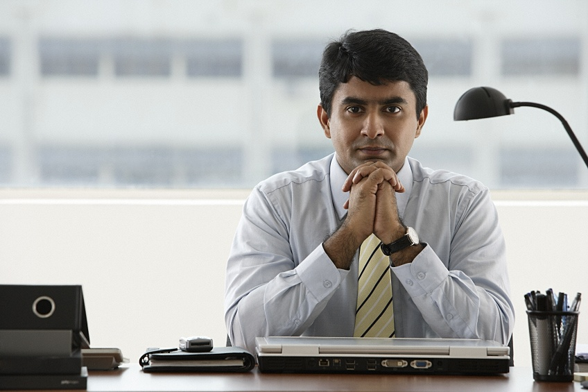 a foreign businessman going through the H1B visa renewal process