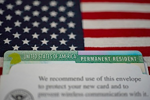 a green card received by a worker in the US who was on an H1B visa