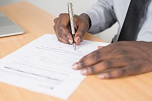 documentation for an H1B visa renewal being signed by an immigration attorney
