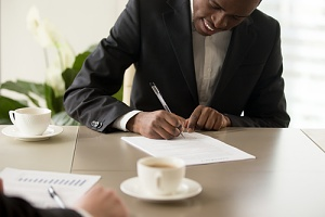 young man filling out seasonal worker visa application