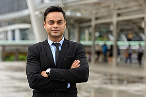 an Indian businessman who is in the United States on a 2020 H1B visa