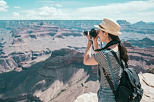 Tourist on B2 Visa taking photo of Grand Canyon