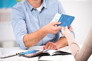 Visa worker handing over visa