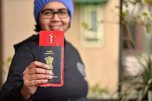 Woman holding H-1B visa