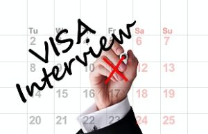 a calendar with the words visa interview on it