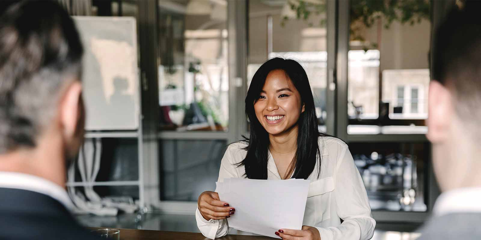 a-woman-smiling-and-confident-in-a-visa-interview
