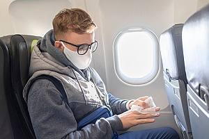 an immigrant flying to the United States during the COVID-19 pandemic