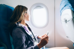women flying in a plane coming with a q visa