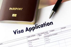 passport lays on top of q visa application