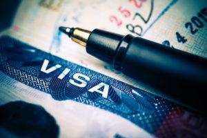 pen lays next to the q visa