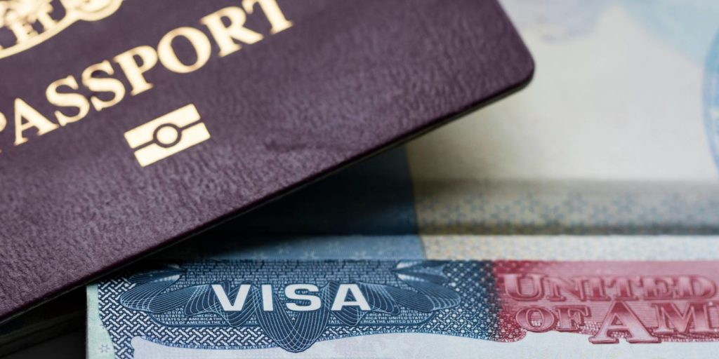 passport of a permanent labor certification applicant sits adjacent to the visa