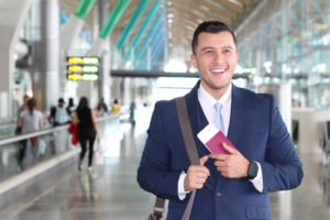 permanent labor certification recipient smiles while walking in the airport