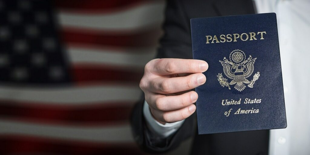 Man Holding US Passport- K1 Visa Process
