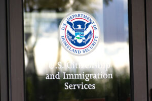 a USCIS building door that the tourist and fiance enter before filling out the visa forms