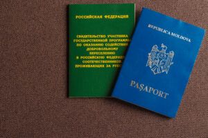 the passports lay together as the tourist and fiance fill out the visa forms