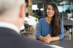 female candidate laughing at job interview