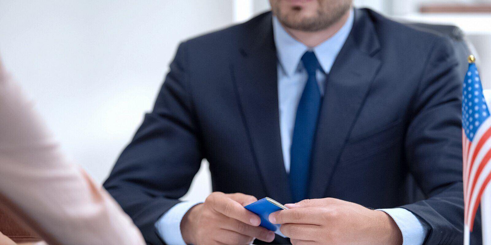 man holding passport preparing for k1 visa interview