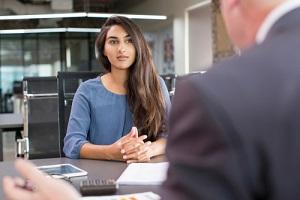 focused indian female during visa interview