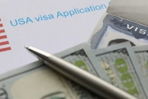 us visa application with dollars and pen