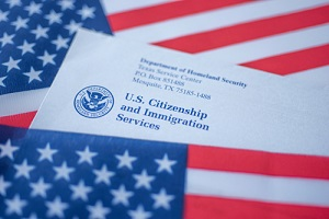 uscis covered in flag of usa on american colors background